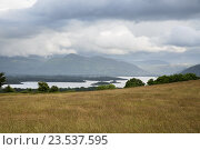 Купить «view to lake and hills at connemara in ireland», фото № 23537595, снято 24 июня 2016 г. (c) Syda Productions / Фотобанк Лори