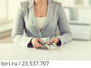 Купить «close up of woman hands counting us dollar money», фото № 23537707, снято 2 июля 2015 г. (c) Syda Productions / Фотобанк Лори