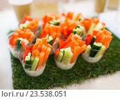 Купить «close up of vegetable snacks on table decoration», фото № 23538051, снято 11 июня 2016 г. (c) Syda Productions / Фотобанк Лори