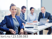 businesswoman with glasses with team on the back, фото № 23538083, снято 9 ноября 2013 г. (c) Syda Productions / Фотобанк Лори