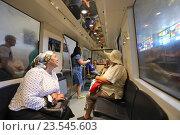 Купить «Интерьер электропоезда Эп-563 с туристами в Новоафонской пещере, Абхазия», эксклюзивное фото № 23545603, снято 23 июля 2016 г. (c) Алексей Гусев / Фотобанк Лори