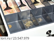 Купить «Деньги в кассе», эксклюзивное фото № 23547979, снято 18 сентября 2016 г. (c) Яна Королёва / Фотобанк Лори