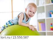 Купить «Kid having fun with gymnastic ball», фото № 23550587, снято 29 февраля 2016 г. (c) Оксана Кузьмина / Фотобанк Лори
