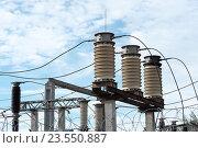 Купить «Фарфоровые изоляторы на электрической подстанции», эксклюзивное фото № 23550887, снято 15 сентября 2016 г. (c) Александр Щепин / Фотобанк Лори