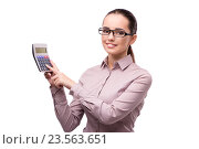 Купить «Young businesswoman with calculator isolated on white», фото № 23563651, снято 29 июля 2016 г. (c) Elnur / Фотобанк Лори