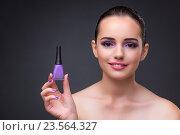 Купить «Woman with bottle of manicure polish», фото № 23564327, снято 3 августа 2016 г. (c) Elnur / Фотобанк Лори