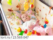 Младенец в кроватке. Редакционное фото, фотограф Дмитрий Голуб / Фотобанк Лори