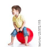 Купить «happy child jumping on bouncing ball», фото № 23572115, снято 10 апреля 2015 г. (c) Оксана Кузьмина / Фотобанк Лори