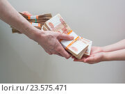 hand with stack of Russian money. Стоковое фото, фотограф Алексей Суворов / Фотобанк Лори