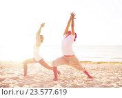 Купить «couple making yoga exercises outdoors», фото № 23577619, снято 6 августа 2014 г. (c) Syda Productions / Фотобанк Лори