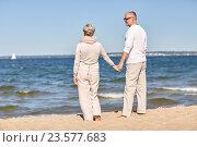Купить «happy senior couple holding hands summer beach», фото № 23577683, снято 18 августа 2015 г. (c) Syda Productions / Фотобанк Лори
