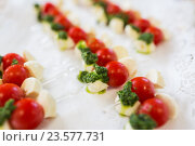 Купить «close up of mozzarella and cherry tomato canape», фото № 23577731, снято 11 июня 2016 г. (c) Syda Productions / Фотобанк Лори