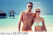 Купить «happy couple in swimwear hugging on summer beach», фото № 23577891, снято 11 августа 2015 г. (c) Syda Productions / Фотобанк Лори