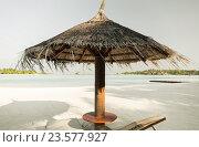 Купить «palapa and sunbeds by sea on maldives beach», фото № 23577927, снято 11 февраля 2016 г. (c) Syda Productions / Фотобанк Лори