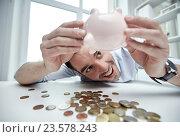 Купить «businessman with piggy bank and coins at office», фото № 23578243, снято 18 июня 2015 г. (c) Syda Productions / Фотобанк Лори
