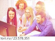 Купить «smiling business team looking at computer monitor», фото № 23578351, снято 1 февраля 2014 г. (c) Syda Productions / Фотобанк Лори