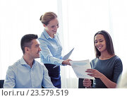 Купить «smiling business people with papers in office», фото № 23579519, снято 25 октября 2014 г. (c) Syda Productions / Фотобанк Лори