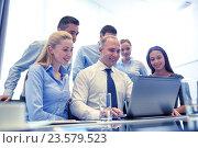 Купить «smiling business people with laptop in office», фото № 23579523, снято 25 октября 2014 г. (c) Syda Productions / Фотобанк Лори