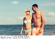 Купить «happy couple in swimwear walking on summer beach», фото № 23579551, снято 11 августа 2015 г. (c) Syda Productions / Фотобанк Лори