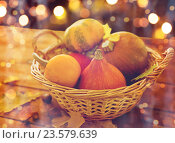 Купить «close up of pumpkins in basket on wooden table», фото № 23579639, снято 19 октября 2015 г. (c) Syda Productions / Фотобанк Лори