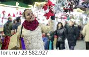Купить «Portrait of female customer», видеоролик № 23582927, снято 2 декабря 2015 г. (c) Яков Филимонов / Фотобанк Лори