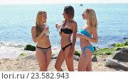 Купить «three young women friends in bikini», видеоролик № 23582943, снято 22 июня 2016 г. (c) Яков Филимонов / Фотобанк Лори