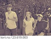 Купить «Positive parents with son running in park», фото № 23619003, снято 17 мая 2014 г. (c) Яков Филимонов / Фотобанк Лори