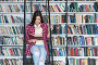 Teenager in library, фото № 23619299, снято 8 апреля 2016 г. (c) Raev Denis / Фотобанк Лори