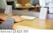 Купить «clerk counting money and customer at bank office», видеоролик № 23621151, снято 19 сентября 2016 г. (c) Syda Productions / Фотобанк Лори