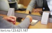 Купить «clerk counting money and customer at bank office», видеоролик № 23621187, снято 19 сентября 2016 г. (c) Syda Productions / Фотобанк Лори