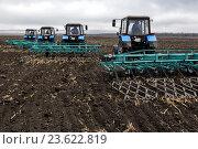 Купить «Посевные работы. Трактор работает в поле.», эксклюзивное фото № 23622819, снято 20 марта 2015 г. (c) Андрей Дегтярёв / Фотобанк Лори