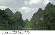 Купить «In Trang an bai in Hanoi, Vietnam seen picturesque landscape of river», видеоролик № 23625775, снято 10 июня 2016 г. (c) Данил Руденко / Фотобанк Лори