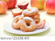 Купить «Сладкие пончики на тарелке и красные яблоки», фото № 23638431, снято 20 сентября 2016 г. (c) Надежда Нестерова / Фотобанк Лори