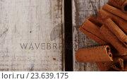 Купить «Star anise, cinnamon and jingle bells on a plank», видеоролик № 23639175, снято 2 июля 2020 г. (c) Wavebreak Media / Фотобанк Лори