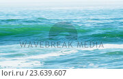 Купить «View of waves on seashore», видеоролик № 23639607, снято 15 июля 2019 г. (c) Wavebreak Media / Фотобанк Лори