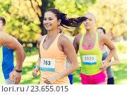 Купить «happy young sportsmen racing wit badge numbers», фото № 23655015, снято 16 августа 2015 г. (c) Syda Productions / Фотобанк Лори