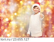Купить «smiling happy boy in santa hat showing thumbs up», фото № 23655127, снято 6 ноября 2015 г. (c) Syda Productions / Фотобанк Лори