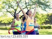 Купить «happy young female runner winning on race finish», фото № 23655331, снято 16 августа 2015 г. (c) Syda Productions / Фотобанк Лори