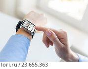 Купить «close up of hands with online shop on smart watch», фото № 23655363, снято 13 августа 2015 г. (c) Syda Productions / Фотобанк Лори