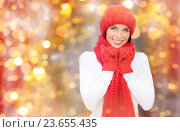 Купить «happy woman in hat, scarf and mittens over lights», фото № 23655435, снято 15 августа 2013 г. (c) Syda Productions / Фотобанк Лори
