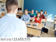 Купить «group of students and teacher at school lesson», фото № 23655575, снято 22 апреля 2016 г. (c) Syda Productions / Фотобанк Лори