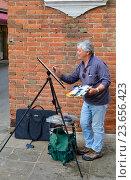 Художник на улице в Венеции (2013 год). Редакционное фото, фотограф Окунев Александр Владимирович / Фотобанк Лори
