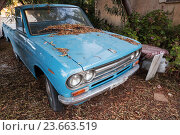 Купить «Blue datsun 1300 pickup car», фото № 23663519, снято 16 августа 2016 г. (c) EugeneSergeev / Фотобанк Лори