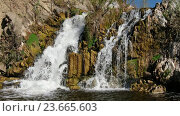 Купить «Водопад на реке Выдриха под Белово в Новосибирской области / Waterfall and rocks on river Vydriha near village Belovo in Novosibirsk region, Russia», видеоролик № 23665603, снято 29 сентября 2016 г. (c) Serg Zastavkin / Фотобанк Лори
