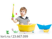 Купить «Cute little baby fishing on white background», фото № 23667099, снято 4 апреля 2014 г. (c) Оксана Кузьмина / Фотобанк Лори