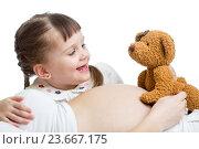 Купить «kid girl telling a tale to baby in pregnant mother's belly», фото № 23667175, снято 31 марта 2014 г. (c) Оксана Кузьмина / Фотобанк Лори
