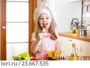 Купить «Chef kid tasting healthy food», фото № 23667535, снято 14 февраля 2014 г. (c) Оксана Кузьмина / Фотобанк Лори