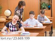 Купить «Schoolchildren work at lesson», фото № 23669199, снято 11 мая 2013 г. (c) Оксана Кузьмина / Фотобанк Лори