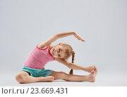 Купить «girl enjoying yoga», фото № 23669431, снято 18 января 2016 г. (c) Константин Юганов / Фотобанк Лори