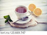 Купить «Чашка чая с лимоном», фото № 23669747, снято 7 января 2016 г. (c) Вероника Галкина / Фотобанк Лори